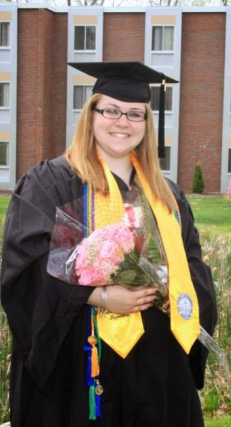 Kelsey Knect posing in regalia on Graduation Day 2014.