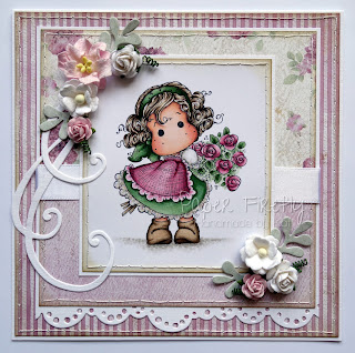 Floral pink handmade card featuring Tilda hiding rose bouquet by Magnolia Rubberstamps