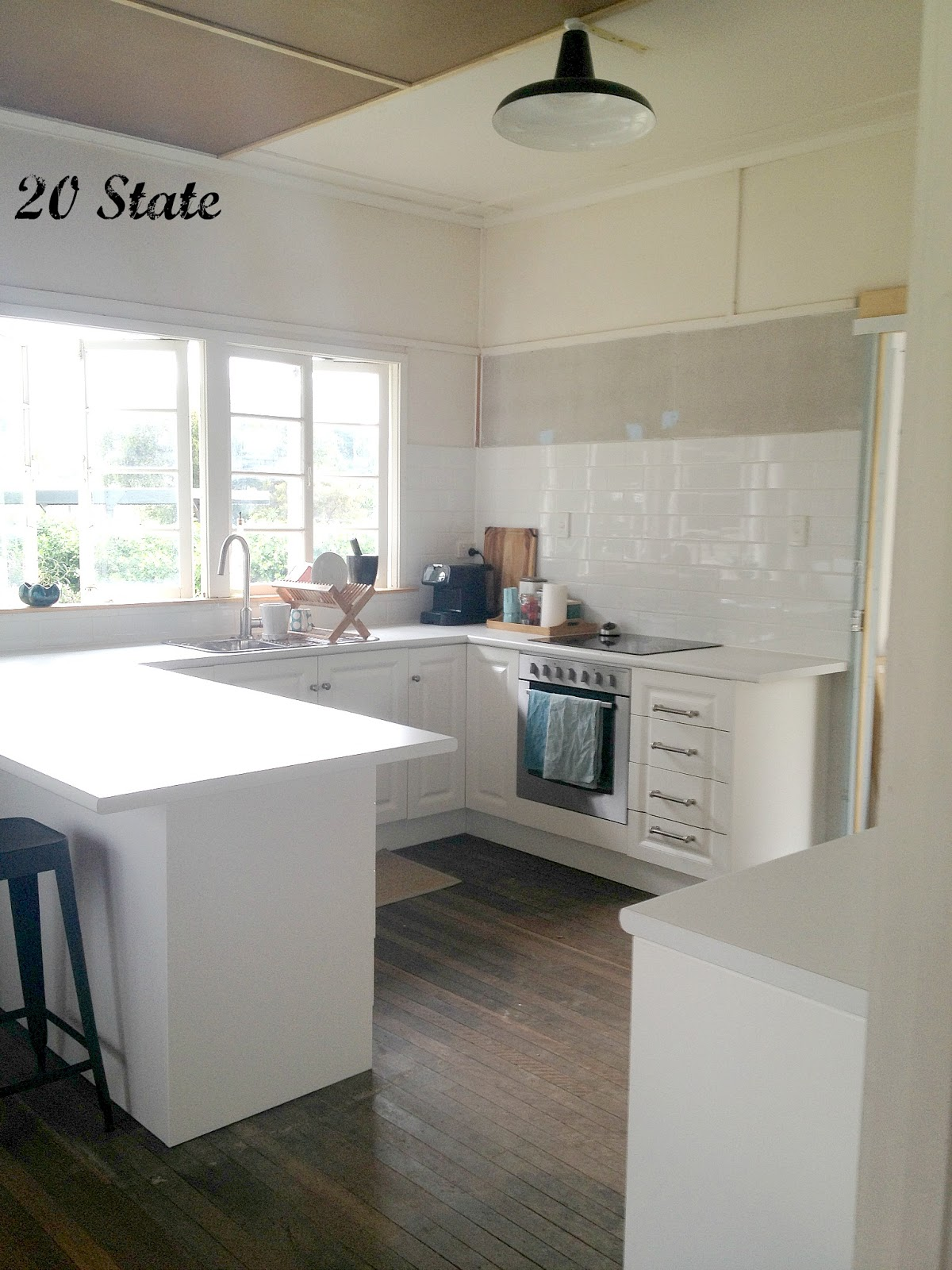 20 State: White flatpack U shaped kitchen with island - just add