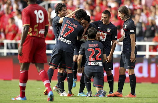 Atlético Madrid's Radamel Falcao celebrates with team-mates after scoring against América de Cali