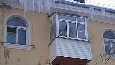 Остекление балкона алюминиевым профилем и сайдингом