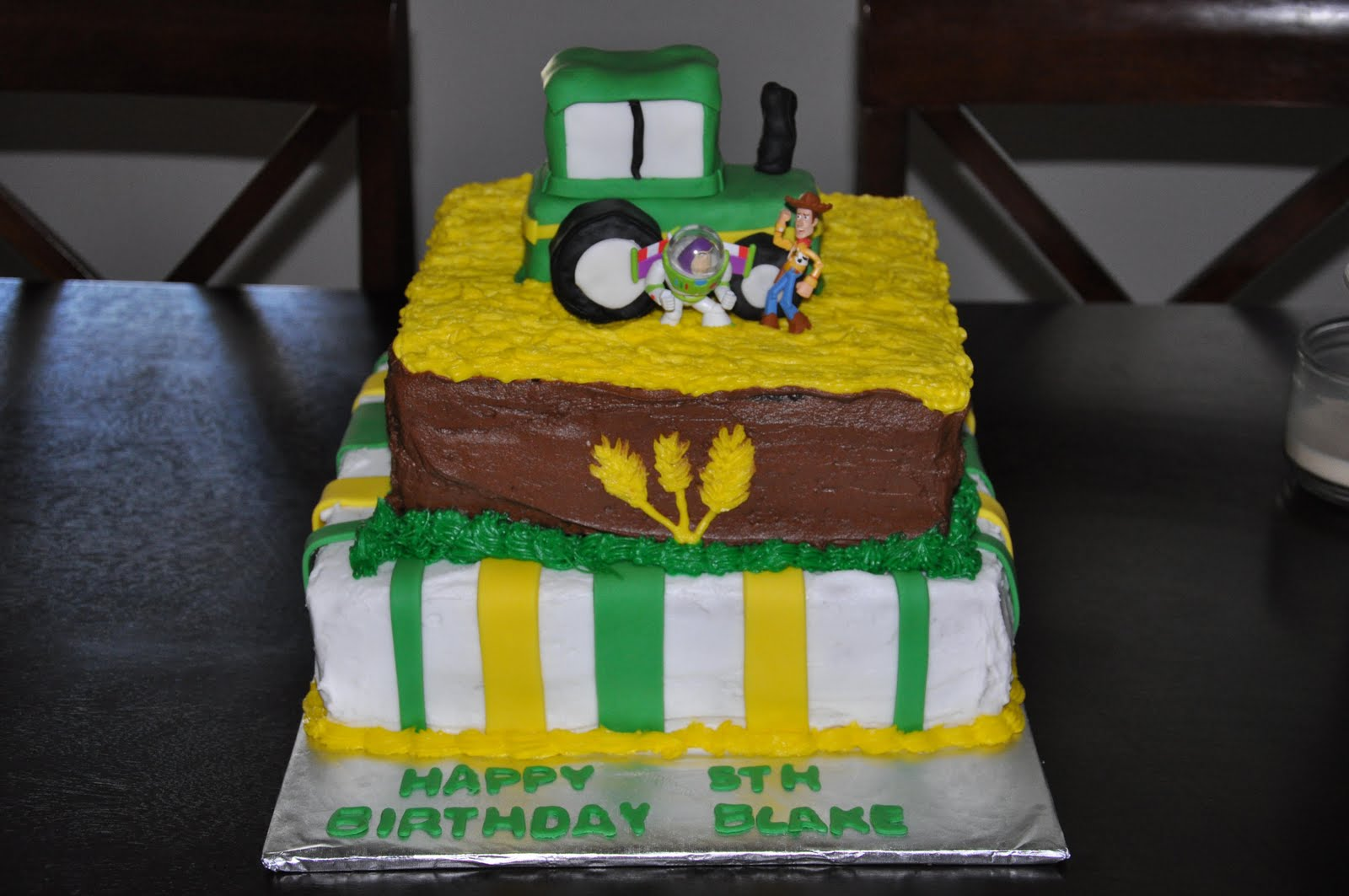 This Is A Two Tiered Tractor Birthday Cake With RKT Covered In Fondant On Top It Was Combined And Toy Story Themed Party So The Mom