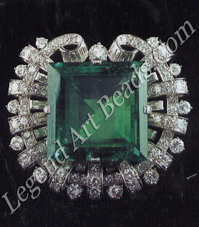 "The clip of a 75-carat emerald, surrounded by 138 diamonds (1 950), is known as the ""Hooker"" emerald after its original owner, Janet Annenberg Hooker."