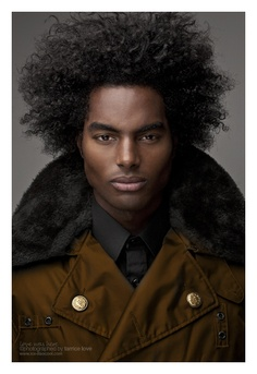 A black man with natural long hair