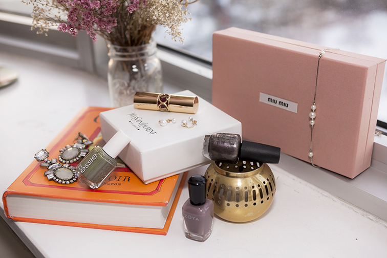 Pink Miu Miu box, vintage pearls, gold plated votive, Zoya nail polish in Normani, Essie in Sew Psyched, YSL rouge volupté, Bauble Bar opal galactic pendant earrings, window sill