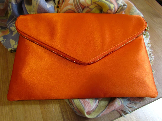 Orange satin clutch bag