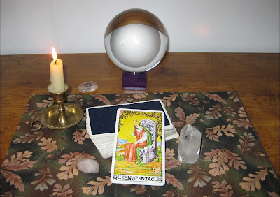 Where Amber TurtleOak reads Tarot cards; with a crystal ball, candle, crystal, and rose quartz.
