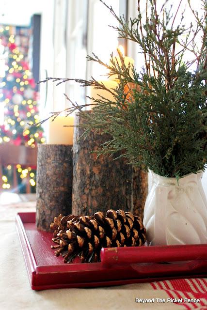 Christmas centerpiece, woodland, branches, pinecones, logs, candles, Christmas decor, http://bec4-beyondthepicketfence.blogspot.com/2015/12/12-days-of-christmas-day-8-woodland.html