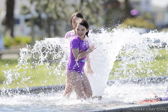 L-R: Georgea Reece-Bowring, 9, Shayla Reece-Bowring, 8, Taradale, Napier - Families picnic and kids play in the pool, fountains near the National Aquarium of New Zealand, Marine Parade, Napier, in the hot sunny weather. photograph
