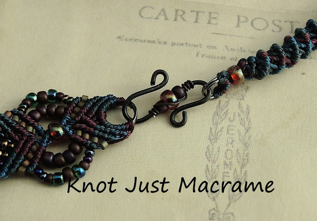 A closeup of the hand made clasp with matching beads and a bit of wire wrapping