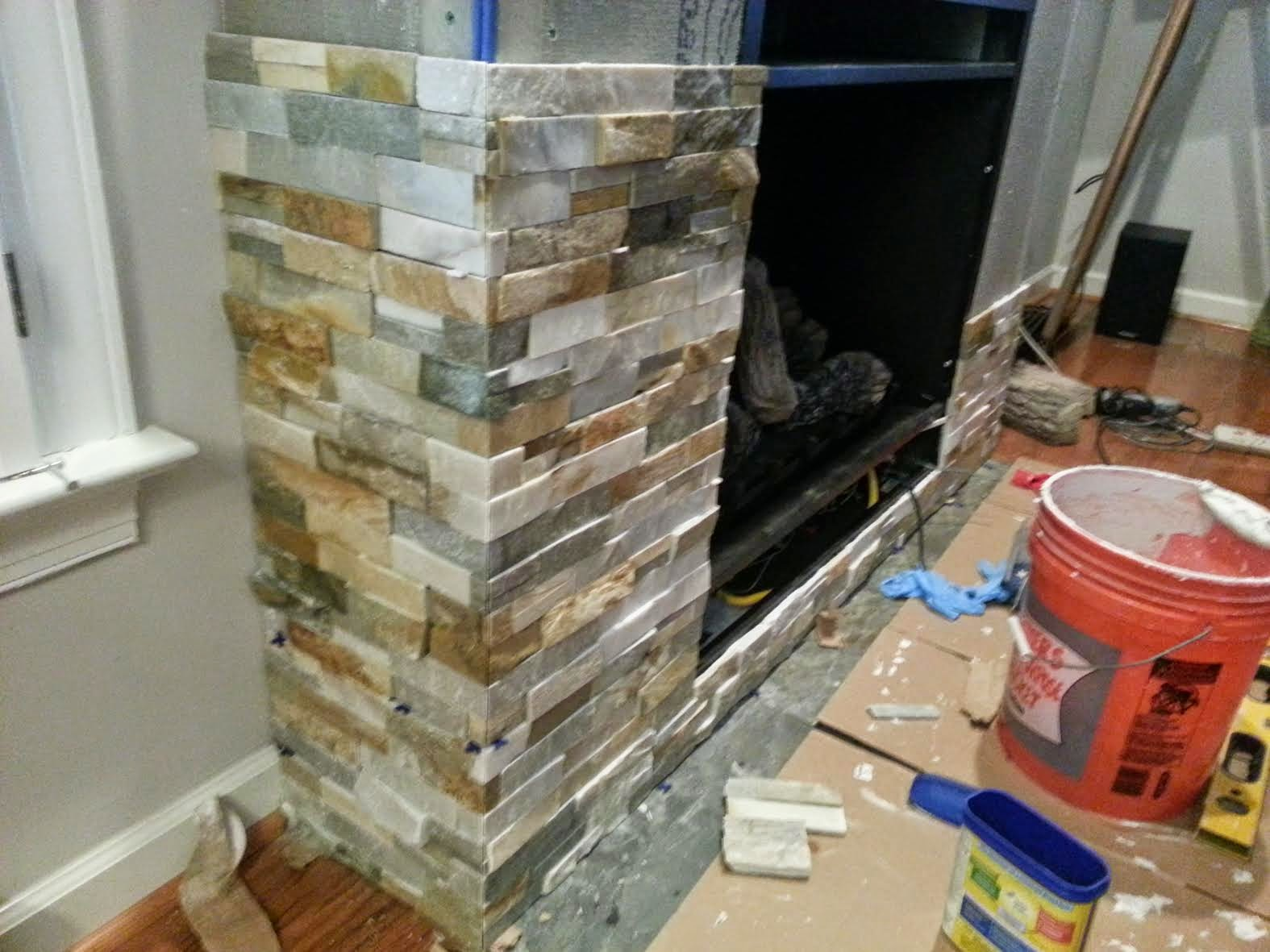 I found this split-face quartz stacked stone at Lowe's. It took about 60  square feet to finish the fireplace. I love how Patrick cut the edges. - Decor You Adore: Why You Want A Vent-Free Fireplace
