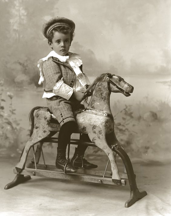 Fashion Toys For Boys : Old fashioned kids with large toy horses sweet juniper
