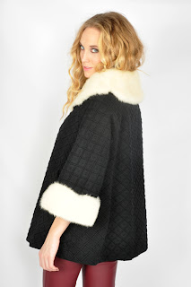 Vintage 1960's black wool swing coat with white mink collar and cuffs.