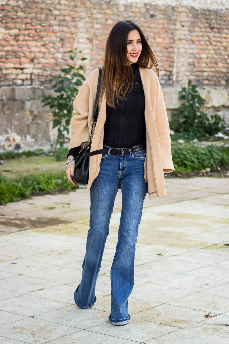 camel coat and flared jeans
