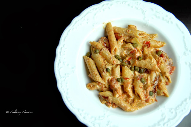 penne with sun dried tomatoes, tomatoes, artichokes and ricotta cheese!