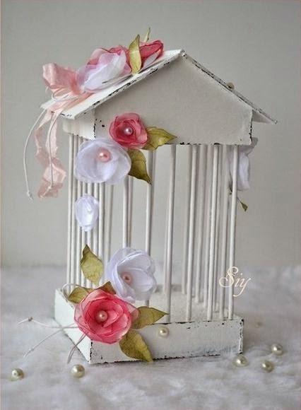 jaula, cartón, tela, palillos, flores