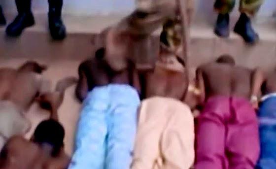 Suspected Boko Haram members taking abuse by anti-Haram militia members. (Screen capture form YouTube video)