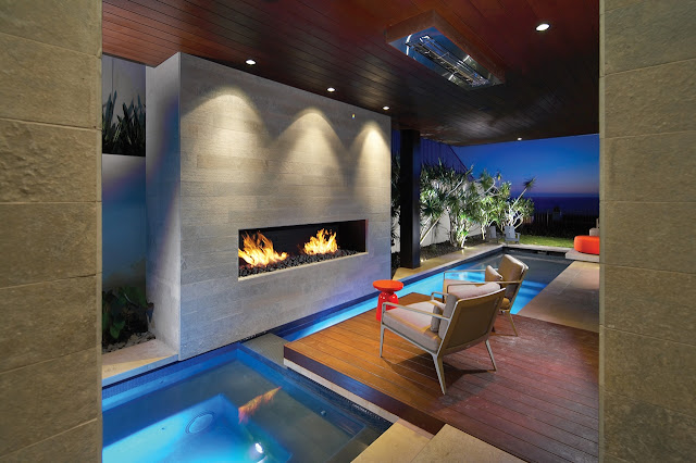 Picture of the outdoor fireplace by the swimming pool