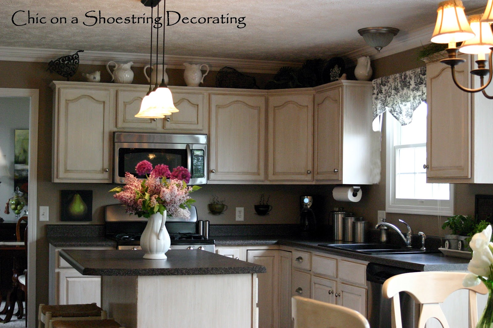 Decor for tops of kitchen cabinets best home decoration How to decorate the top of your kitchen cabinets