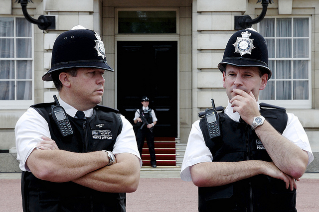 Two policeman guarding Buckingham Palace