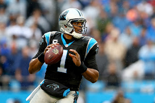 Cam Newton takes on the Green Bay Packers