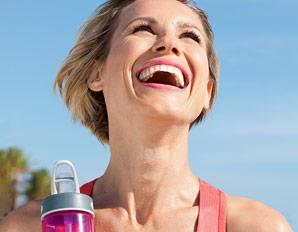woman-laughing-water-bottle-الضحك علاج فعال للأمراض النفسية والعضوية