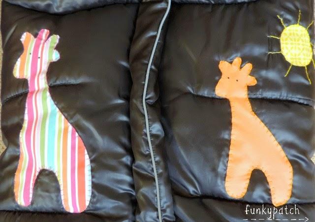 Saquito para silla de paseo con aplicaciones de dibujos infantiles hechos a mano