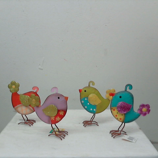 http://shop.tmigifts.com/metal-bird-with-glitter-wings-9-tall-4-styles-priced-per-each-212150/dp/6740