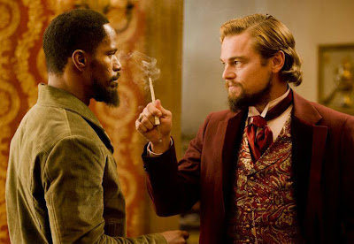 jamie foxx as django, leonardo dicaprio as calvin candie, django unchained directed by quentin tarantino