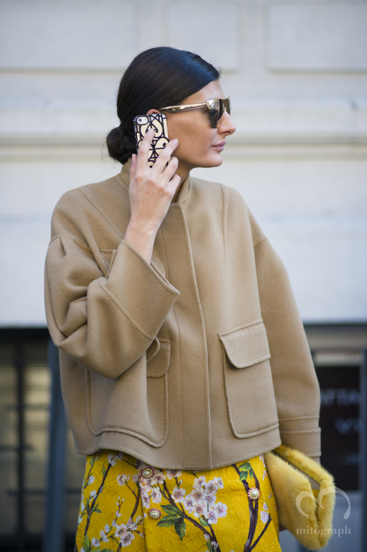 Stylist Giovanna Battaglia carries her own design iphone case during Milan Fashion Week 2014 Fall WInter MFW