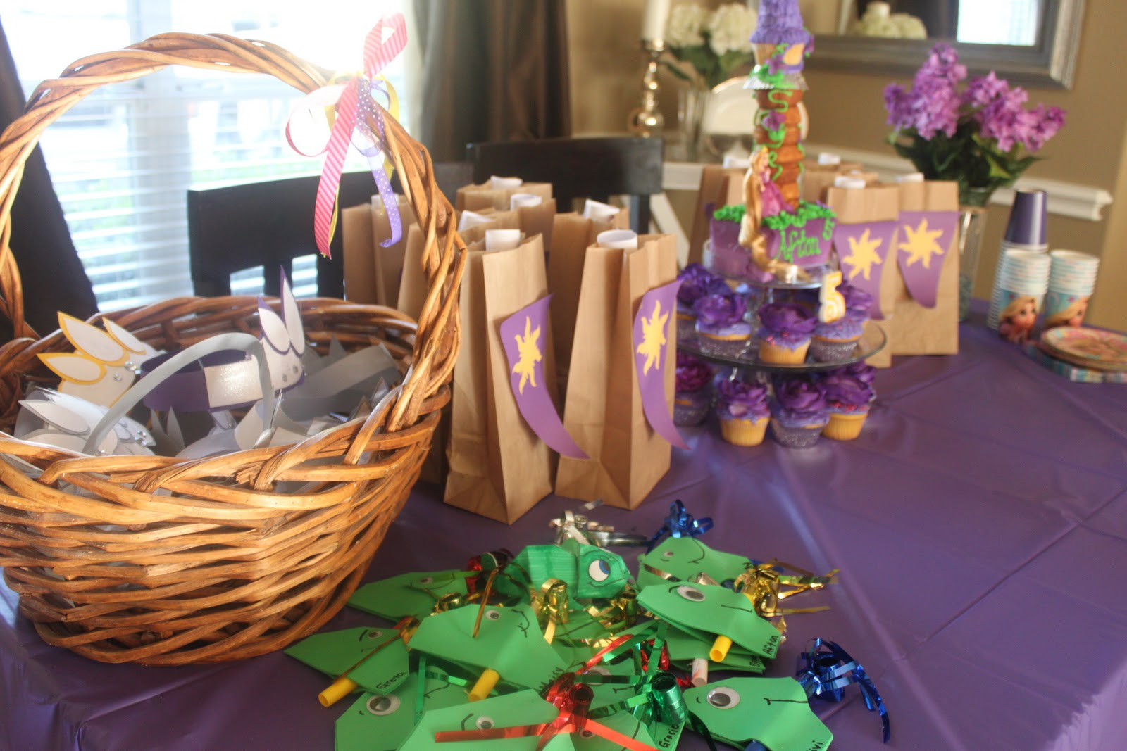 The table was decorated with goody bags, Rapunzel crowns and Pascal