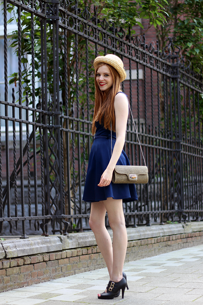 Vintage retro style fashion blogger outfit with cut-out boots, a straw bowler hat and a polka dot belt