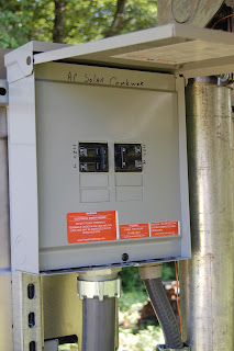 Junction box combining the AC power from the 2 inverters