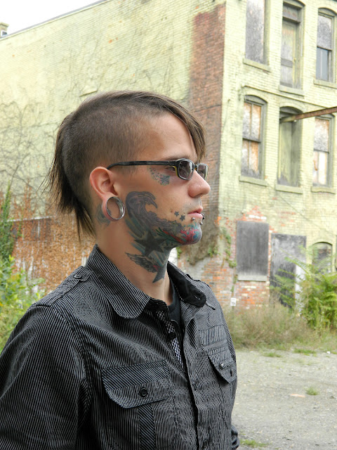 mohawk and tattoos, male tattooed model alt alternative rocker style, Eighty Eight Platinum, DIY jeans