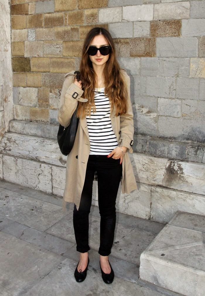 Parisian chic wearing a trench coat with stripes