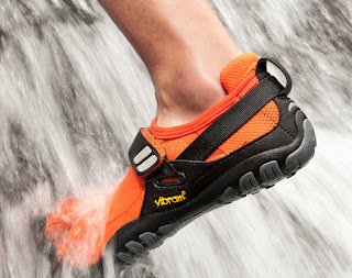 Picture of Vibram 5 Fingers minimalist shoes climbing in water.