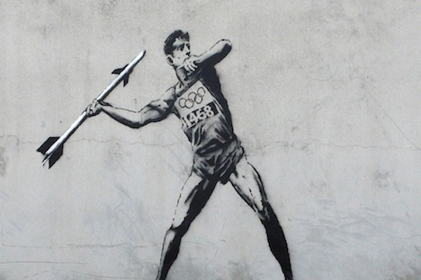 street art of javelin thrower using missile