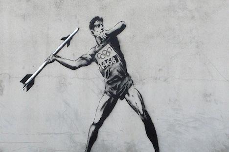 street art of javelin thrower using missile