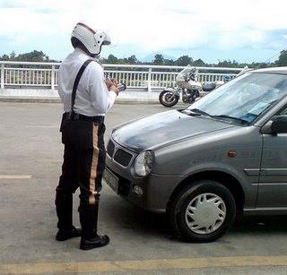 polis Malaysia Penguin on Road