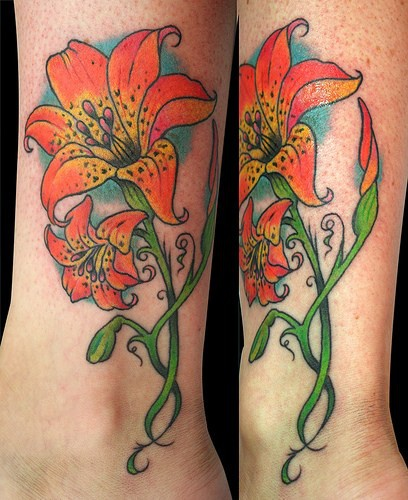 Elegant orange flower tattoo