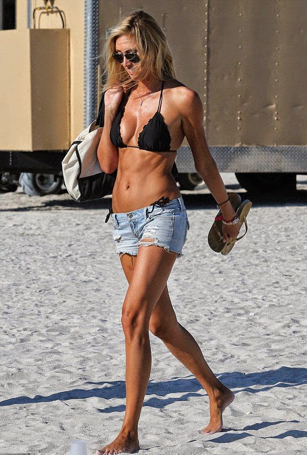 Lauren Stoner wears a black bikini at Miami