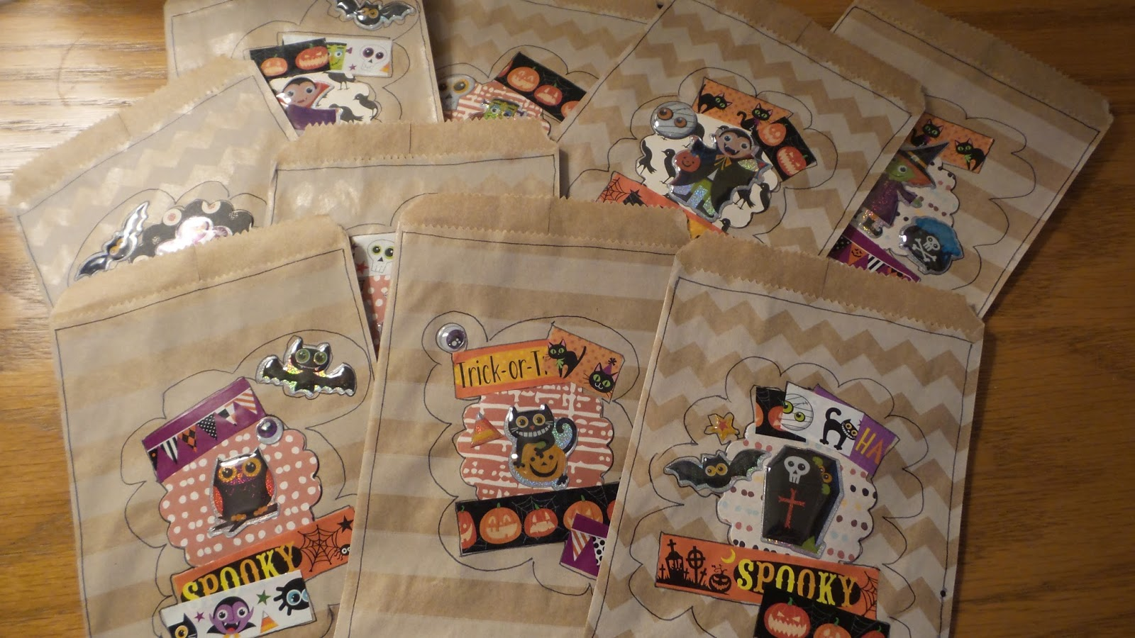 cute lunch bags decorated for halloween treats using washi stickers from the dollar tree