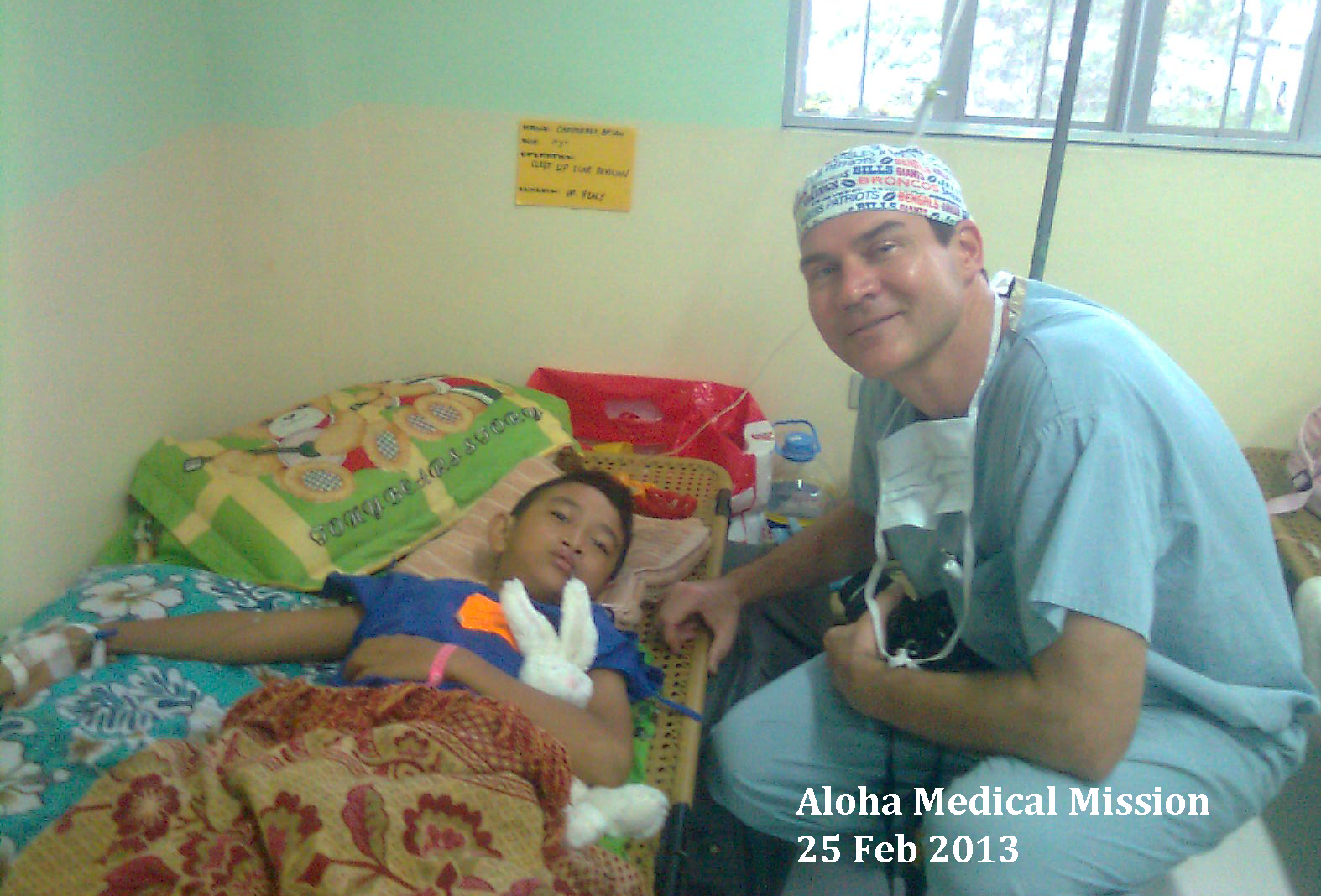 Bryan with Dr. Jeff Healy who operated his cleft lip