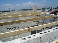 Cite Soleil, Haiti 2011: Almost ready to replace the roof on one of the rebuilt homes