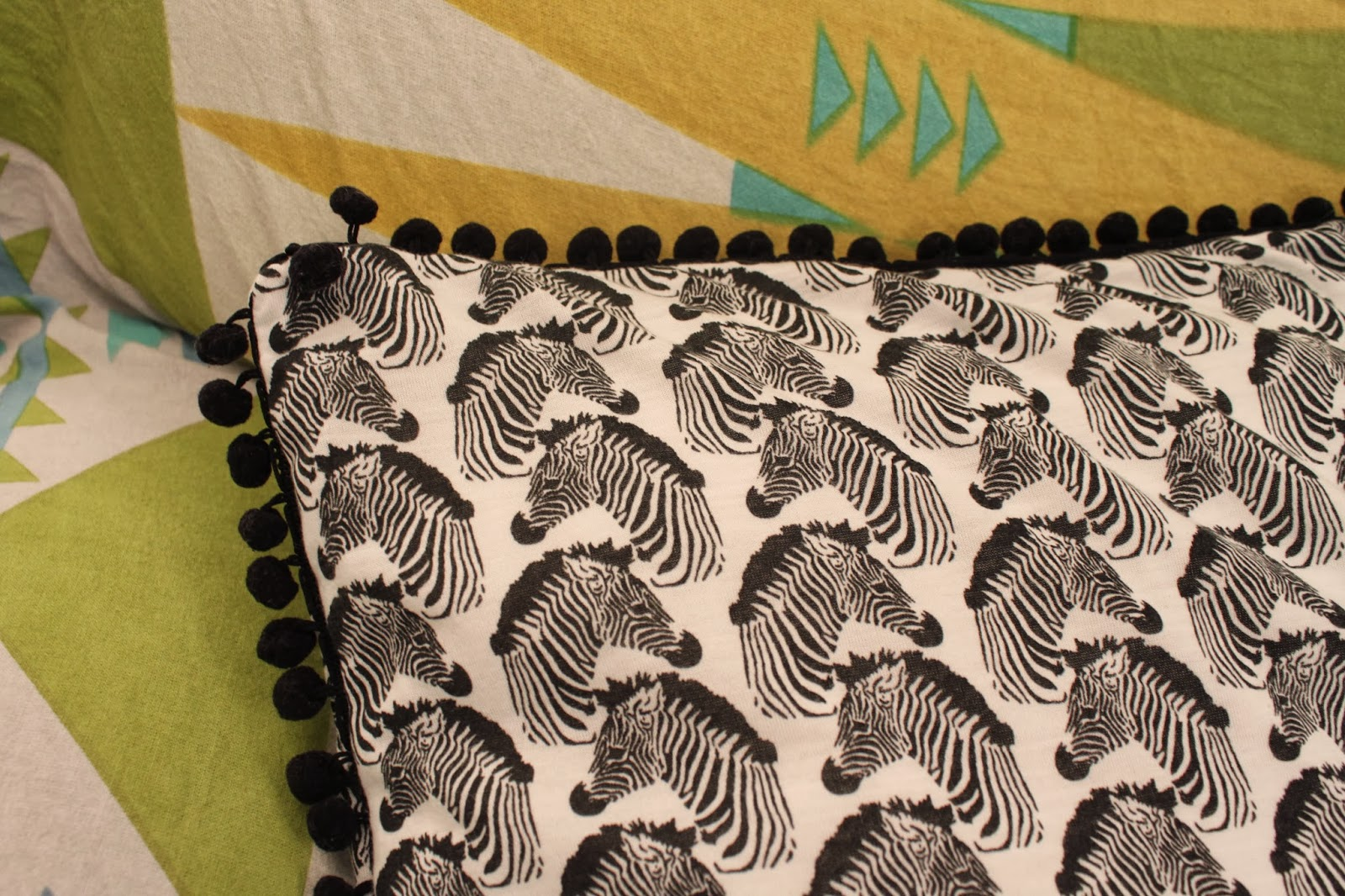 diy zebra pom pom cushion