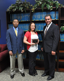 Smith received her scholarship award from Wardens Vernon Pitman (l) and Tony O'Hare(r)