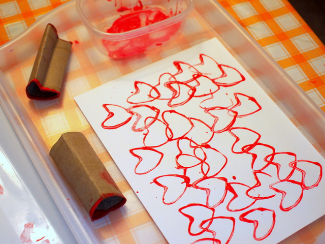 stamping hearts with toilet paper rolls and tempera paint