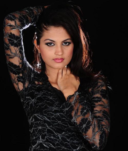 madhulika in black dress cute stills