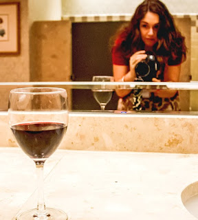 Image of woman taking a photo of a wineglass