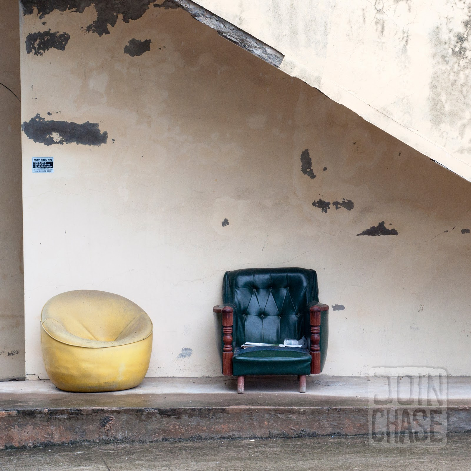 Chairs in front of an old building along the Geum River Bike Path in South Korea.